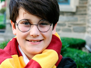 boy in Harry Potter costume